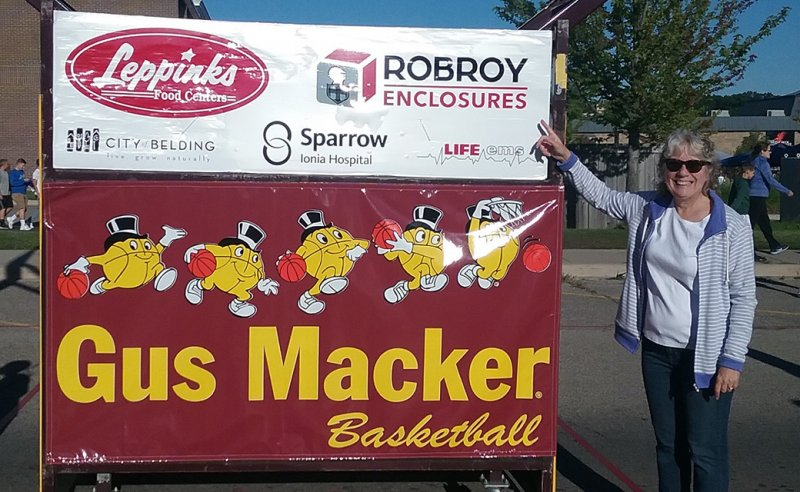 Robroy employee with Gus Macker Basketball Tournament sign